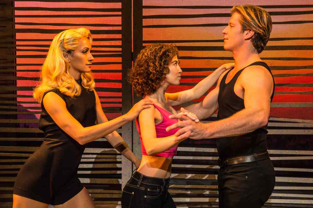 jennifer_mealani_jones_(penny),_bronwyn_reed_(baby)_and_christopher_tierney_(johnny)_in_the_north_american_tour_of_dirty_dancing_–_the_classic_story_on_stage._(photo_by_matthew_murphy)
